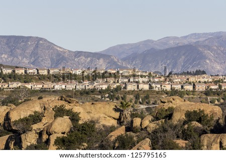 Modern California hillside homes in the Porter Ranch neighborhood of Los Angeles's San Fernando Valley. - stock photo
