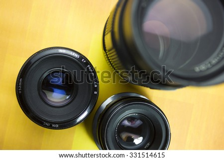 Modern camera lenses with reflections - stock photo