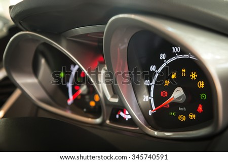 Modern car dashboard left side view. Show all led signs. (Focus on speedometer indicator and shallow depth of field) - stock photo