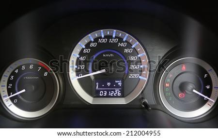 Modern car illuminated dashboard  - stock photo