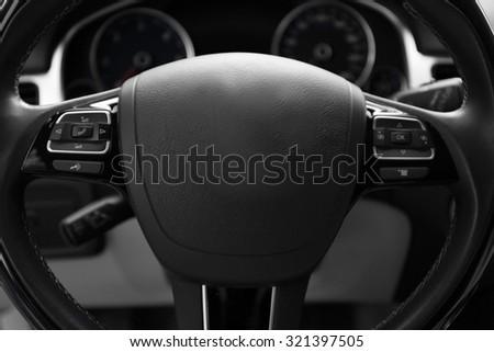 Modern car illuminated dashboard and steering wheel - stock photo