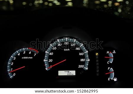 Modern car illuminated dashboard closeup ready to start - stock photo