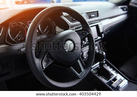 Modern car interior dashboard and steering wheel