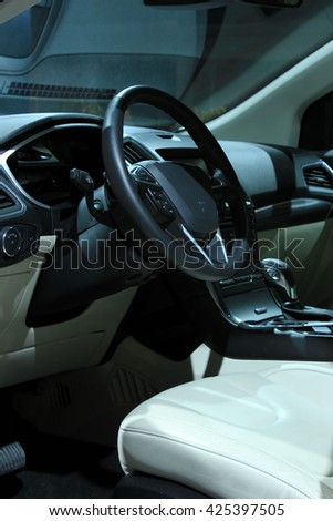 Modern car interior, luxurious materials in different shades of grey