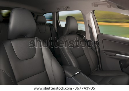 Modern car interior with motion sunny weather blur in the windows - stock photo
