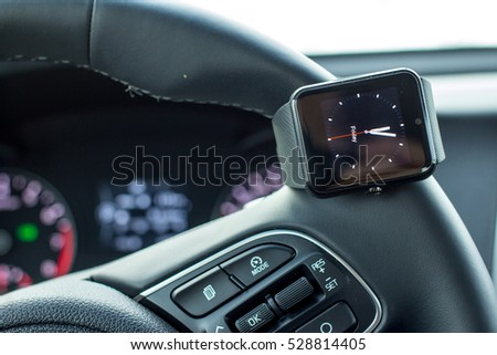 Modern car interior with smart watch in steering wheel