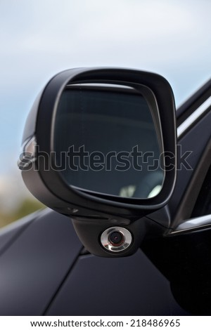 Modern car mirror with blind spot camera - stock photo