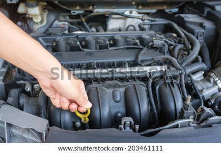 modern car need maintainance with engine oil - stock photo