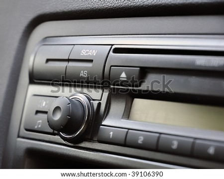 Modern car radio with knob, buttons and LCD display - stock photo