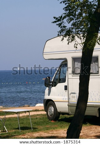 modern caravan at the campsite - stock photo