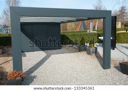 Modern carport car garage parking made from black metal and glass - stock photo