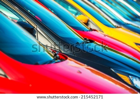 Modern Cars Stock Closeup. Colorful Cars Waiting For New Owners. Car Sales Industry. - stock photo