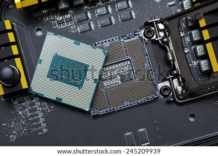 Modern central processor unit on motherboard - stock photo