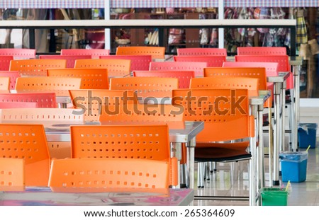 Modern chair and table in the food court. - stock photo