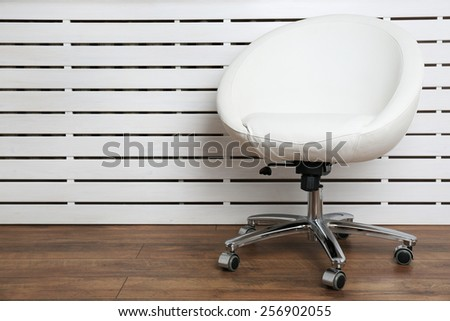 Modern chair on white wooden planks background - stock photo