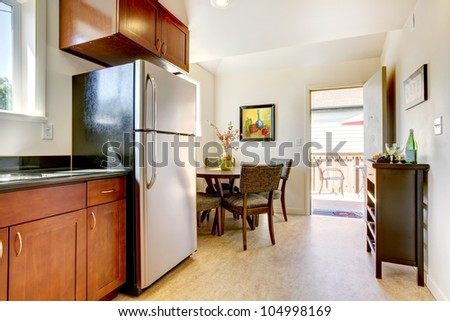 Modern cherry kitchen with steal appliances and open door. - stock photo