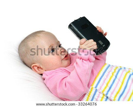 modern children -  baby with pocket pc - stock photo