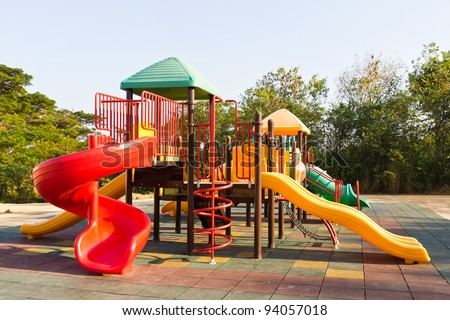 Modern children playground in park - stock photo