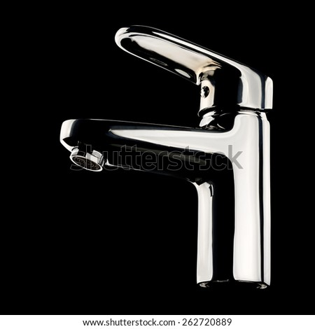 Modern chrome faucet on black background. With clipping path