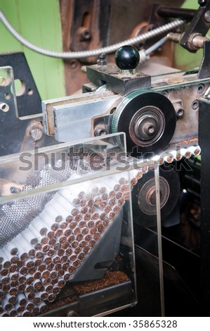 Modern cigarette factory, process of production - stock photo
