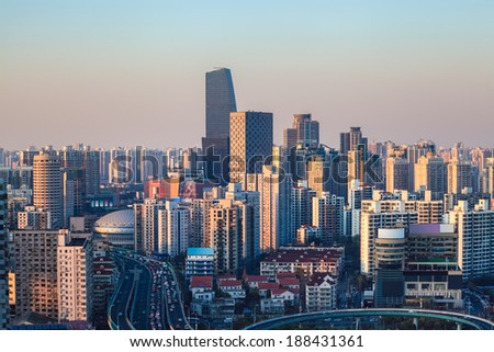 modern city at dusk ,aerial view of urban forest buildings  - stock photo