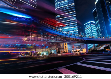 Modern city at night. Shanghai Lujiazui finance street. city night photo, city night light, city night bus, city night moving, city night way, city night shanghai, city night traffic, city light urban - stock photo
