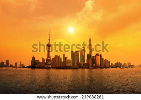 modern city at sunrise,Shanghai skyline - stock photo