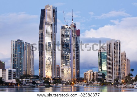 modern city at twilight on horizontal format (gold coast, queensland, australia) - stock photo