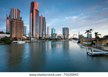 modern city at twilight on vertical format (gold coast, queensland, australia) - stock photo