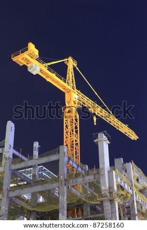 modern city, Building under construction, the yellow crane - stock photo