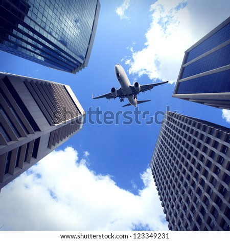 Modern city buildings and aircraft in Brisbane - stock photo