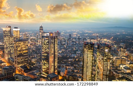Modern city buildings and skyscrapers. City skyline at sunset.