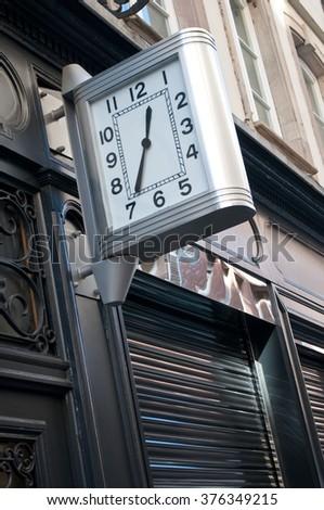 modern city clock in the street  - stock photo