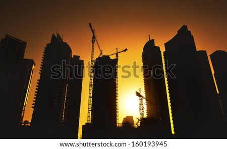 Modern city growing up, Construction with crane - stock photo