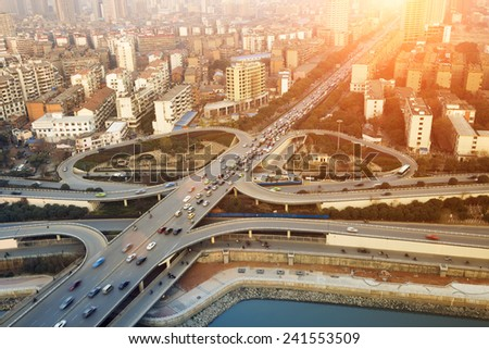 modern city interchange junction at dusk  - stock photo