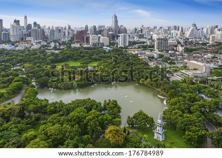 Modern city of Bangkok, Thailand and Suan Lum (Lumpini Park) - stock photo