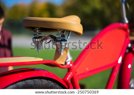 modern city red bike with leather saddle - stock photo