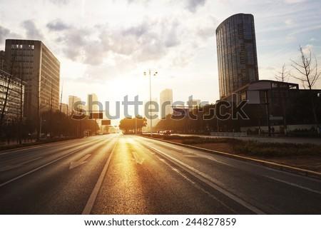 modern city road scene at sunset - stock photo