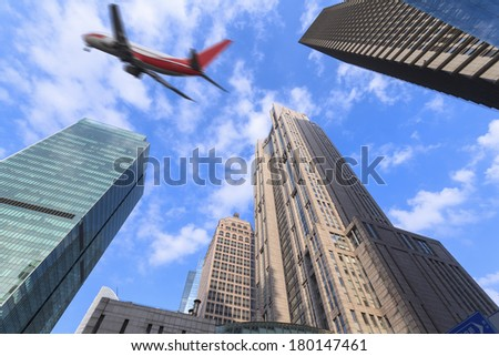 Modern city Shanghai and aircraft - stock photo