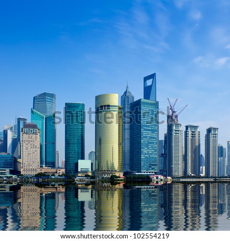 modern city,shanghai skyline in daytime - stock photo