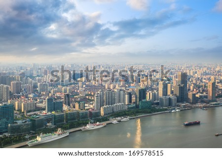 modern city skyline aerial view with huangpu river at dusk  - stock photo