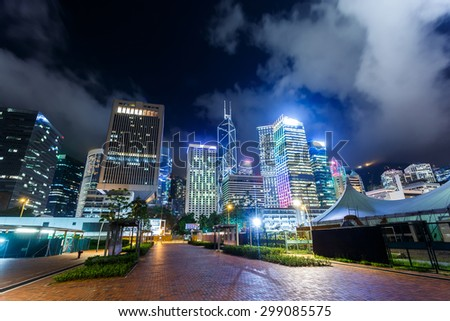 Modern city skyline and urban street at night - stock photo