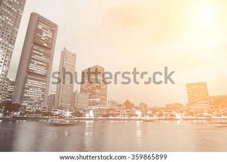 Modern city skyline with buildings near river in night in Singapore, Asia. - stock photo
