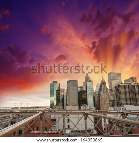 Modern city skyline with dramatic sky. Buildings and skyscrapers at sunset.