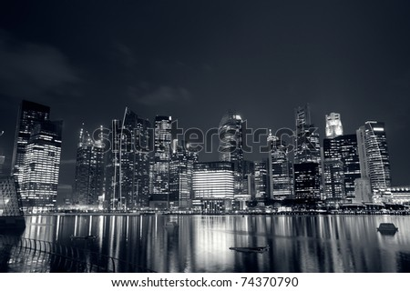 Modern city skyline with reflection on river in Singapore, Asia.