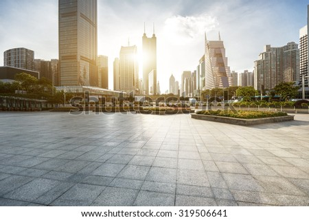 modern city square and skyscrapers under sunshine - stock photo