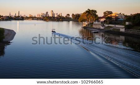 Modern city, sunset. (City of Gold Coast, Queensland, Australia) - stock photo