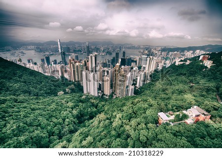 Modern city surrounded by forest and sea. - stock photo