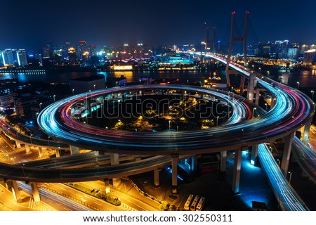 Modern city traffic road at night. transport road junction on the bridge.  - stock photo