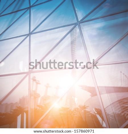 modern city urban futuristic architecture reflection in glass with fantasy light - stock photo